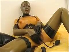 Woman Wearing Latex Pumps Up Her Tits And Pussy