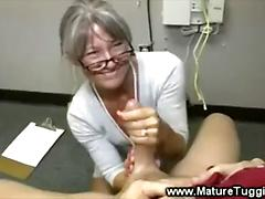 Horny mature wanks off a hard cock