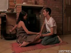 Passionate teen couple fuck on the floor by a fire-place