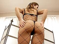 Stunning girl in fishnet fucks herself with a silver dildo toy